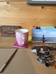 Cup, pencil, sketchbook, photo, keys
