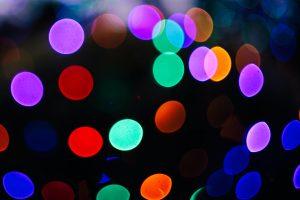 Coloured lights and black background photo by dominik vanyi on Unsplash