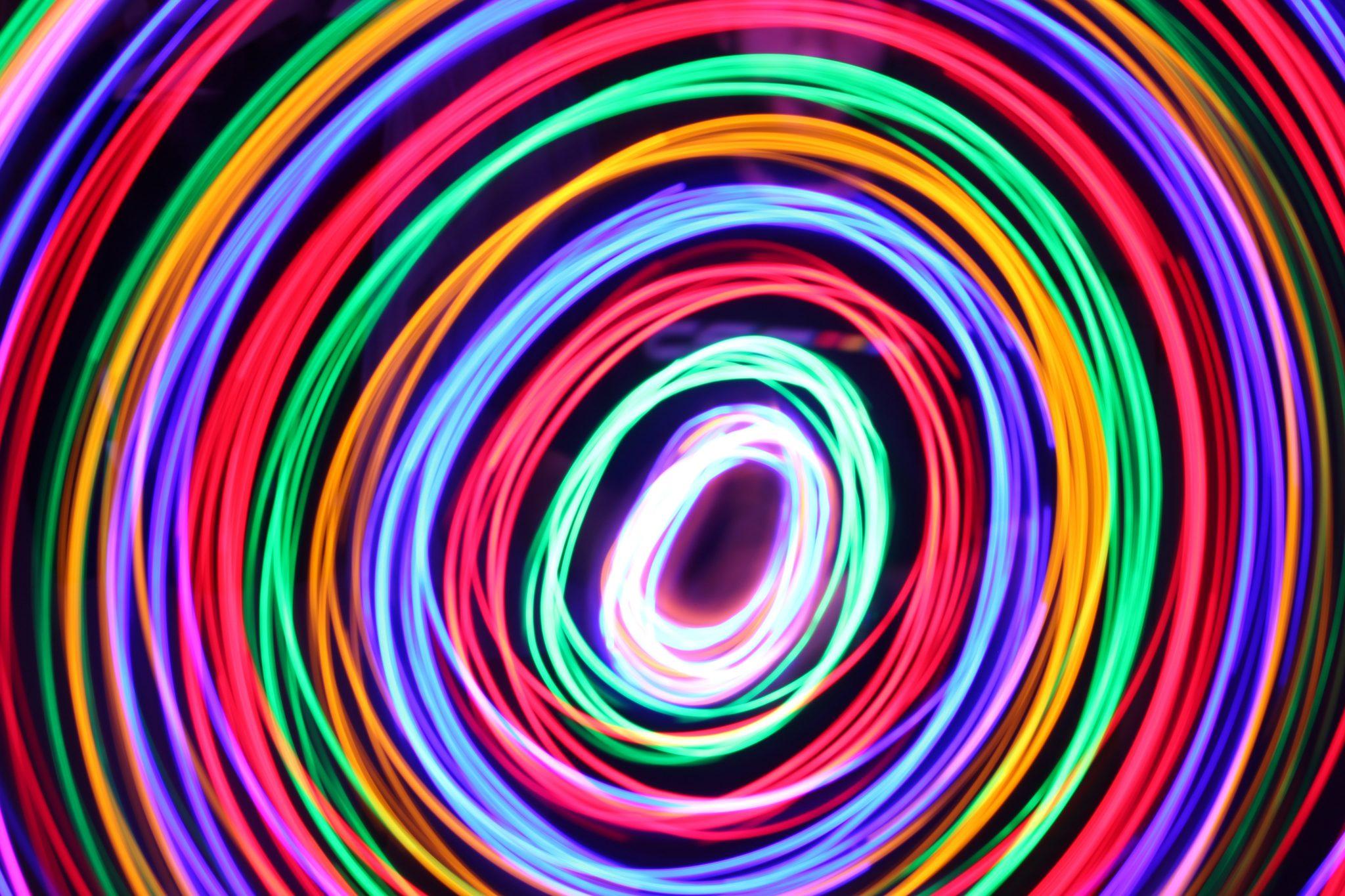 Circular coloured lights photo by paola galimberti on usplash