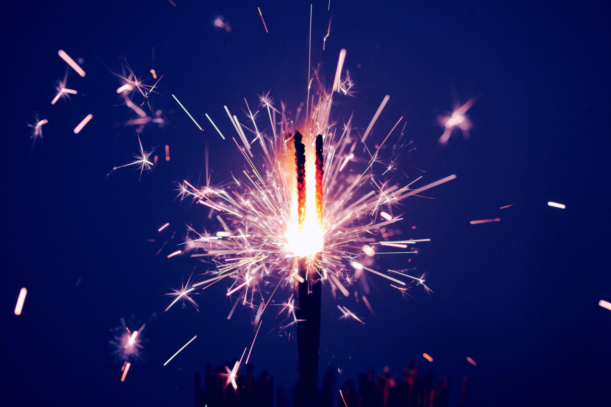 Photo of sparkling firework by sharon mccutcheon on unsplash
